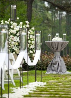 White flowers, ribbons, and floating candles - gorgeous wedding decorations for the ceremony!