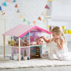 KidKraft Pastel Swivel Deluxe Dollhouse - Watch your little girl and her friends delight in the KidKraft Pastel Swivel Deluxe Dollhouse. They'll love playing with it and spinning it back and f...