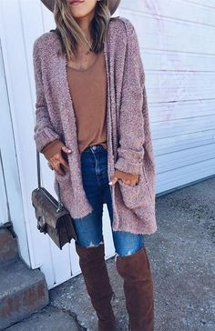 A soft, infatuating pink gives this fuzzy cardigan its sweet appeal. Slip into this chic piece of outerwear and layer with ease.
