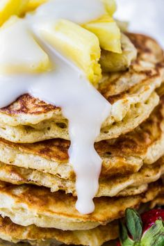 Banana Macadamia Pancakes from The Food Charlatan // Fluffy buttermilk banana pancakes studded with macadamia nuts, smothered in coconut syrup. Just like you had in Hawaii! These are so easy to make at home.