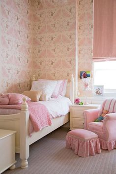 A monkey-patterned wallpaper adds whimsy to this perfectly pink child's bedroom - Traditional Home®️️    Photo: Joe Standart