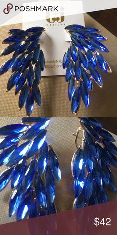 T + J Designs Luxe Wing Crystal Earring Beautiful Cobalt Blue Wing design earrings by t+j designs.  Glass crystal earring in feather pattern with gold metallic post back.  2.75 length. 1.5 width.  The perfect statement pop! t+j designs Jewelry Earrings