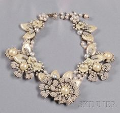 Vintage Imitation Pearl Flower Necklace, Miriam Haskell, the flower motifs with imitation seed pearl petals, plastic florets and leaves with mother-of-pearl finish, and joined by imitation pearls, metal findings, lg. to 15 1/2 in., signed.