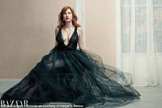 Jessica Chastain cleavage in a plunging tulle and emerald green Valentino Couture gown