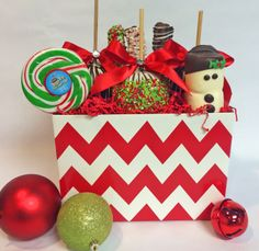 Large Cheveron Christmas Basket: *3 Large apples of choice (use same) *3 Variety Gourmet Pretzels *1 Snowman Marshmallow *1 Christmas Dizzy Pop $52.00