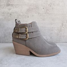 "Vegan nubuck is formed to these stylish almond toe booties with adjustable antiqued silver buckles at the outstep, and goring for fit. 4"""" zipper at the instep."