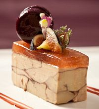 Windows Catering perches a savory macaron on foie gras with fig gelee.  #plating #presentation