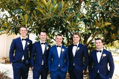 Awesome navy suit groomsmen