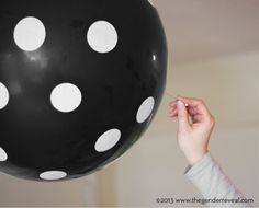 Gender reveal idea! Fill black balloons with the gender-appropriate colored confetti and have everyone pop them at the same time. If you don't want to find out your baby's sex until the celebration, you can have a friend or family member fill the balloons for you.