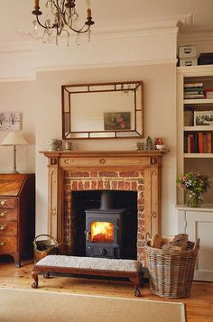 Image result for woodburner with traditional fire surround