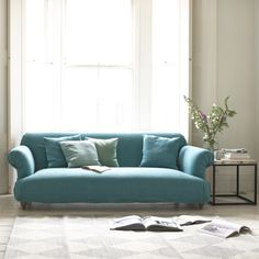 SOUFFLÉ SOFA with removable cover. Puffed up like a pillow, then soft in the middle. Just like one of our favourite dishes. With its rounded corners and squidgy feel, this tasty sofa is blinkin' comfy. #sofa #removablecover #livingroom