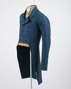 1815: The Empire Period marked a change in men's clothing from decorated to relatively plain. The style changed a focus on fitted tailoring like this double-breasted tailcoat.