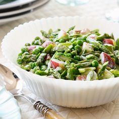 Ready for a new spring salad recipe? Our colorful vegetable salad features red potatoes, asparagus, frozen peas and scallions tossed with a zesty dressing.