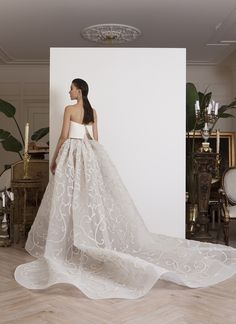 AZZI & OSTA: Strapless see-through off-white organza embroidered gown, with gazar bust and long train.