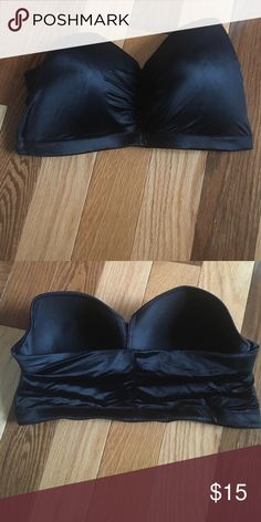 """Black Pull on Strapless 40D or 40 DD This is a pull Strapless never worn. Has strap hooks from and back. Very nice 5"""" band. The outside material has a ver nice satiny feel. Free black velvet straps if you pay asking price. Ask for them after purchase. NWOT could be worn as Bustier Lilyette Intimates & Sleepwear Bras"""