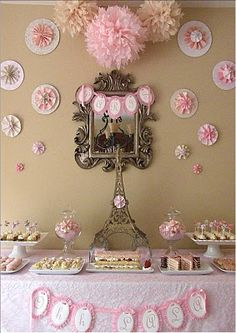 Paris Party. Pink & white DIY, paper craft, accordion folded rosettes.  Girly decoration in pink.  Make in your theme colors for any party or holiday decorating.