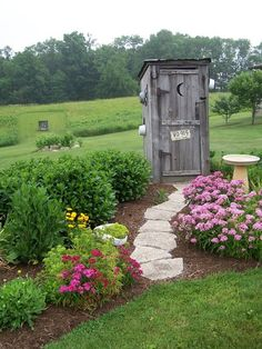 The path (and gorgeous surrounding garden) leads to an outhouse, but maybe it's used as a really handy garden shed.