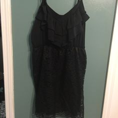 Black dress. A spaghetti strap black dress. It has a ruffle at the top and lace at the bottom. Very comfortable. Xhilaration Dresses Midi