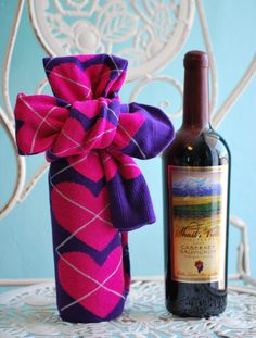Super cute and easy DIY wine gift wrap idea: 1. Pick a pair of socks (preferably otk length) that reminds you of the person. 2. Cover the entire bottle and tie a knot on top. If the sock is too short to make a knot, use a separate ribbon to tie. 3. Enjoy the wine together :)
