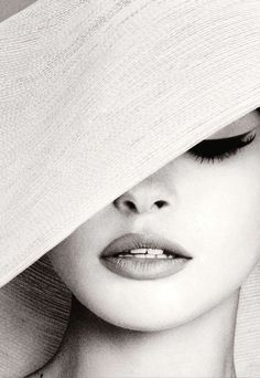 Classic make-up and the mystery of a perfectly placed hat