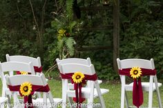 Red and yellow wedding, love the red bow around white chair