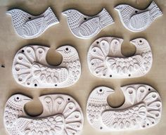 Unfired bisque pieces by Galia Bernstein -illustrator, textile designer and an amateur ceramic artist and printmaker. Some beautiful artwork on her website and blog dancingkangaroo.com clay slab birds