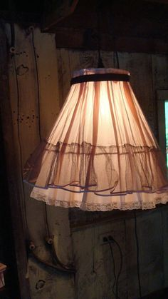 Authentic, Vintage crinoline slips attached to a vintage lamp shade form.