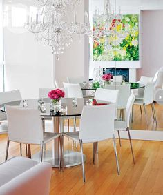 Dining room design: A round dining table, crystal chandelier and large wall mirror visually expands this space {PHOTO: Janis Nicolay}