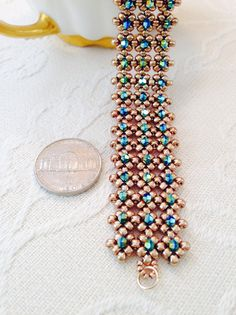 I wove this striking, elegant crystal beaded cuff bracelet from glass seed beads and Swarovski crystals, and finished it with a gold filled lobster claw clasp. The bracelet in the photo is of an inch wide and is 6 inches long, which should fit a Bracelet Swarovski, Beaded Cuff Bracelet, Seed Bead Bracelets, Seed Bead Jewelry, Ankle Bracelets, Seed Beads, Beading Tutorials, Beading Patterns, Bridal Cuff