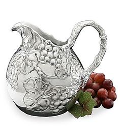 "Arthur Court Grape 1.5 Quart Small Pitcher - #Dillards Featuring an intricate design of intertwining grapes, leaves and vines, this pitcher is made of sand-cast aluminum, hand-finished and buffed to a luminous shine that never needs polishing. Measures 7""x5.5x6.25"" with 1.5-quart capacity."