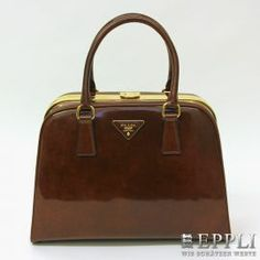 "PRADA current handbag ""BORSA CERNIERA"". EXCELLENT CONDITION! description Tabacco Fume, gold colored fittings, rounded box shape, folding clasp, powder-colored leather lining. Original invoice, aut. Cards and dust bag included.  Listing Price 2100 Euro.  Starting Bid. 990 Euro"