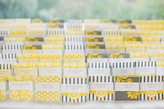 Grey and Yellow Place Cards via Style Me Pretty - Gray and Yellow wedding ideas
