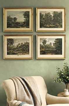 Sage green walls with vintage prints