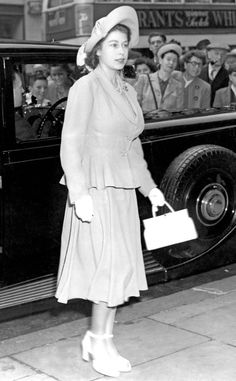 Princess Elizabeth joined her father King George VI at the Derby at Epsom wearing a skirt suit, fascinator and ankle-strap pumps.