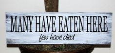 Primitive - Many have eaten here few have died wood sign. $20.99, via Etsy.