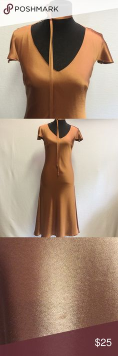 Dress Beautiful form fitting copper colored dress acetate poly blend but looks like silk. Fully lined has small pull see pic 3 and a very tiny stain see pic 4 . It is a size 40 but it's from France and I think it runs small . Tara Jarmon Dresses Midi