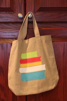 book tote bag using freezer paper stencils Library Bag, Kids Library, Diy Tote Bag, Reusable Tote Bags, Freezer Paper Stenciling, Sewing Machine Projects, Painted Bags, Stamp Printing, Textiles
