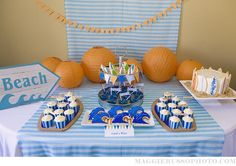 Another gorgeous birthday party from The Homespun Hostess!!!!  This one is surf themed.  How fun is that?  My favorites from this party have to be the blue birthday cake by Little Miss Sweet Tooth & the shark fin punch bowl.  I could photograph the parties Sara creates for hours!