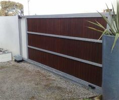 Sliding gate on a gravel driveway