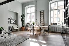 Grey living space in Scandinavian loft