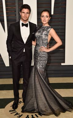 Robbie Amell & Italia Ricci from Vanity Fair Oscars Party 2016: What the Stars Wore | E! Online