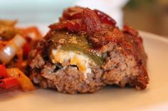 Amazing Smoked Meatloaf stuffed with cream-cheese filled jalapeño and topped with bacon crumbles