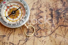 Compass on a map royalty-free stock photo Cartography, Compass, Royalty Free Stock Photos, Map, Accessories, Location Map, Maps, Jewelry Accessories