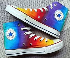 Brighten up your outfit by adding some color to it with these rainbow Converse shoes. These classic high tops provide a superbly comfy fit and come decked out in a blend of bright colors ranging from yellow to turquoise and orange. Rainbow Converse, Cool Converse, Rainbow Shoes, Custom Converse, Outfits With Converse, Custom Shoes, Converse Shoes, Galaxy Converse, Painted Sneakers