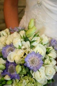 bouquet of green hydrangeas, purple scabiosa, cream ranunculus, fresh lavender, seeded eucalyptus, and rosemary