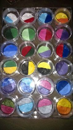 Home made face paint split cakes. Case with 24 twist top round containers is from Michael's. Bought 28 color pallette and the sparkle 8 color kit from Snazaroo. With a Exacto knife, cut 2ml cakes in half and peel them out of the plastic & place the 2 halves you want together in the round containers. Soooo many possibilities.
