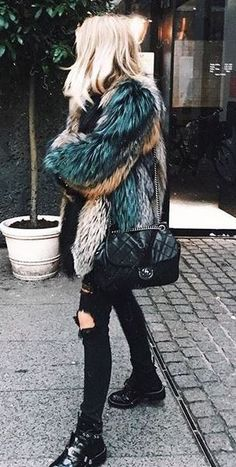 This multi colored fur coat is so cool for winter with these ripped black skinny jeans and leather boots