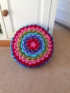 My latest crochet project Rainbow Blooming Flower Cushion