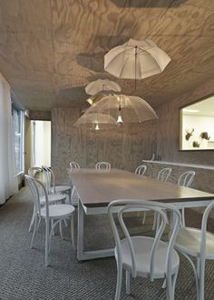 Not only do I love the umbrella lampshades, but the plywood walls are gorgeous.
