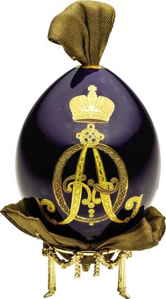 Rare Russian Empress Alexandra Imperial Porcelain Easter Egg By the Imperial Porcelain Factory, St. Petersburg, circa 1910 Decorated with the interlaced Cyrillic monogram A F in two-toned gold for Empress Alexandra Fedorovna (1872-1918), wife of Tsar Nicholas II, on cobalt blue ground with gilded openings, fitted with original silk ribbon-3 1/2 in high, in red leather presentation box. Together with card inscribed Prince Vladimir Galitzine, Objets d'Art 202 Berkeley St, Picadilly W 1.